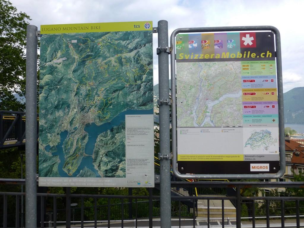 Placa base para as trilhas de mountain bike em Lugano, na Suíça. Notar o quadro explicativo da sinalização.